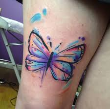 watercolor butterfly on right thigh
