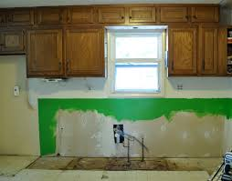 stylish kitchen with distressed cabinets home design image of
