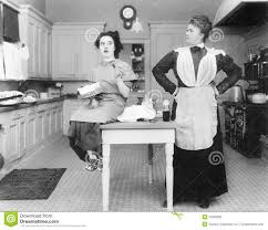 housekeeper in the kitchen glaring at a young woman eating a cake