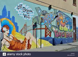 painting mural music street art san francisco sf california usa stock photo painting mural music street art san francisco sf california usa rip dream n vote murals and girls plane 60ies sixties fish shark