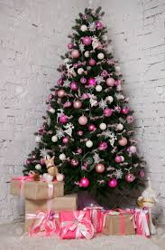 great beautifully decorated christmas tree with pink baubles