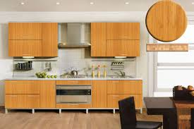 light brown bamboo kitchen cabinets with white countertop on
