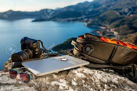 travel photographer images Travel photographer equipment on rocky mountain with beautiful jpg