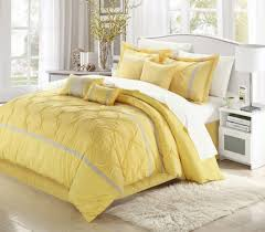 bedroom comfortable white and yellow bedding set with white area