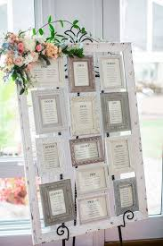 wedding seating chart ideas shades of pale pink and a pronovias gown for a classic and