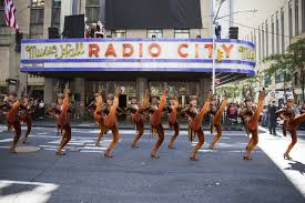 flash the rockettes prance in christmas in august outside radio city