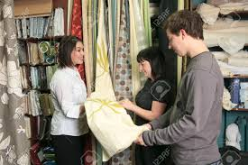 Home Design Shop Inc by A Home Design Shop With Employee Clerk Taling About A Curtain