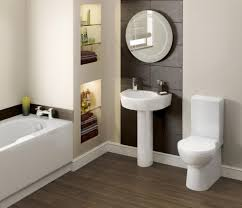 bathroom dark wooden flooring design ideas with round wall mirror