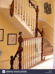 Banister Newel Mahogany Newel Posts And Cream Banisters On Staircase On