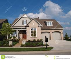Building A Two Car Garage Small Beige Brick Home With Two Car Garage In Fron Stock Image