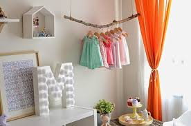 girls bedroom decorating with bright orange color accents and