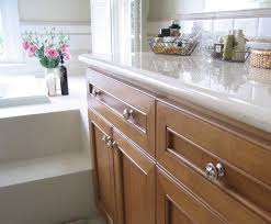 granite countertops kitchen cabinets with knobs lighting flooring