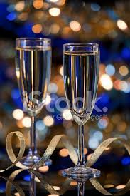 champagne glasses with christmas lights in the background stock