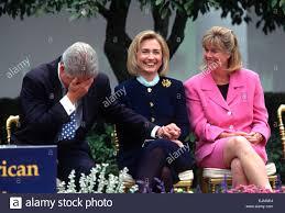 us president bill clinton jokes with first lady hillary clinton