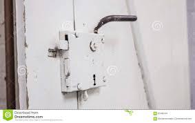 barn door look old barn door lock and handle white stock photo image 65485491