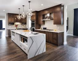 wood kitchen cabinets with white island bright kitchen medium wood cabinets white island