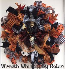 deluxe halloween deco mesh wreath with witch doll in orange black