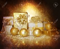picture of christmastime gift boxes isolated on dark golden