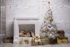 white tree with golden and silver balls gift boxes stock