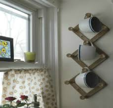 add more kitchen space with these 13 brilliant hook hacks hometalk repurpose a coat rack or trivet