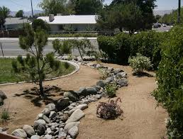 rocks around trees of landscaped backyard ideas landscape grass