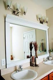 bathroom molding ideas framing mirror crown molding and spray paint so much