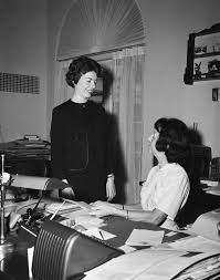 Secretary Under The Desk by Presidential Secretary Evelyn Lincoln With A Guest John F