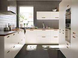 gourmet kitchen for the aspiring chef or seasoned professional ikea a large white kitchen with walnut worktops