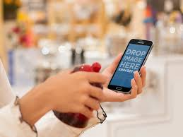 A Home Decor Store Placeit Samsung S5 Mockup Of Woman Shopping At A Home Decor Store