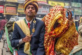 indian wedding groom indian wedding proud groom holding his covered like a trophy