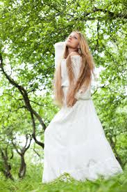 Summer Garden Dresses - beautiful young with long hair and a long white dress stands