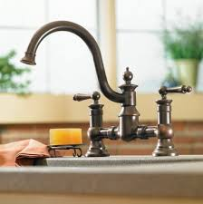 moen kitchen faucets rubbed bronze moen waterhill rubbed bronze two handle high arc kitchen