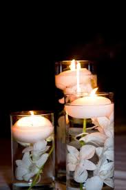 floating candles centerpieces with flowers for wedding table