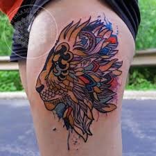 multicolored and watercolor lion tattoo by logan bramlett