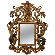 baroque style carved giltwood and painted mirror for sale at 1stdibs