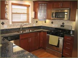 Paint Kitchen Cabinets Before And After Spray Paint Kitchen Cabinets Cork Roselawnlutheran