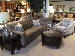 beautiful tufted back sofa paired with houndstooth side chair from