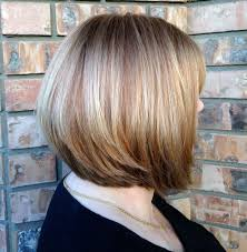 salt and pepper hair with brown lowlights gray coverage resulting in a natural blend of highlights and