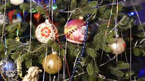 beautiful glass ornaments hanging on a tree
