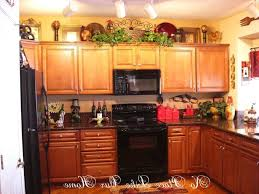 Decorating Ideas For The Top Of Kitchen Cabinets Pictures Decor For Top Of Kitchen Cabinets Kenangorgun