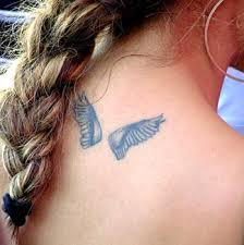 collection of 25 small wings tattoos on back for
