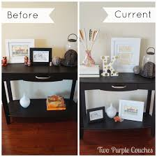 entryway console styling two purple couches