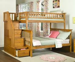 twin bunk beds with stairs drawers on beige floor matched desk on