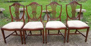 of six antique style mahogany shield back dining chairs by shaw of
