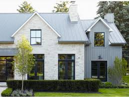 black or dark grey windows and gutters on a white house
