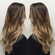 long layered medium brown hair with strawberry blonde balayage