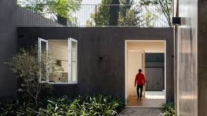 home courtyard modern concrete home in mexico city unfurls around two courtyards