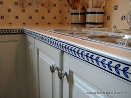 everyday artist hand painted blue u0026 white tile backsplash