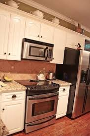 over the range microwave cabinet ideas microwave above stove with raised cabinet above for the home