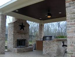 patio ideas built in patio wall medieval style stone fireplace